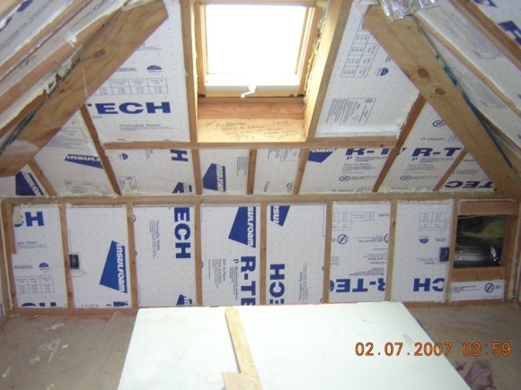 Before The Wallboard Goes Up You Can See Rigid Foam Insulation That Was Installed To Rafters Above This Is An Air E And A